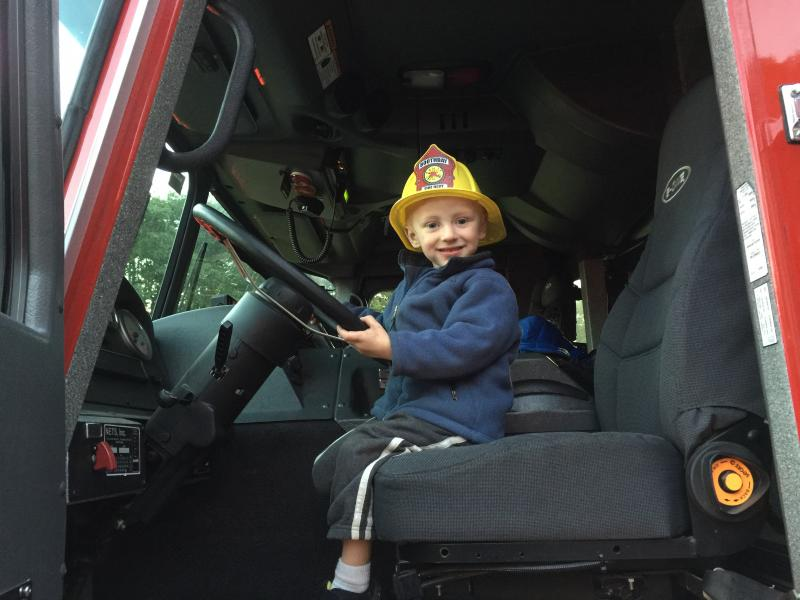 Three Year Old Duncan Scott Sits In The Drivers Seat Of A Boothbay Fire Truck During Open House Event KATRINA CLARK Register