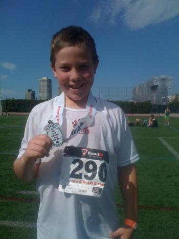 Adam is all smiles after receiving his medal.
