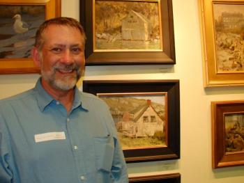 Roger Dale Brown of Nashville poses near some of his paintings.