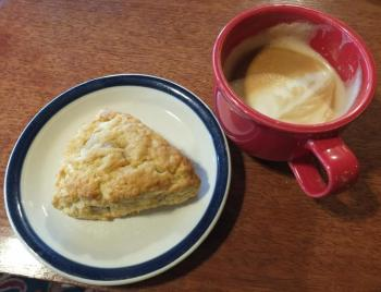 A scone and a latte served in a red cup at Red Cup Coffeehouse. SUZI THAYER/Boothbay Register