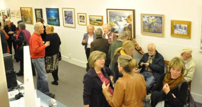 "A crowd gathers Saturday at the third annual ArtinMe event at the Boothbay Region Art Foundation. Bremen's Claire Hancock won best in show for her painting titled ""Pink 'Knock-Out' Roses.""  The event will be on display until November 3. BEN BULKELEY/Boothbay Register"