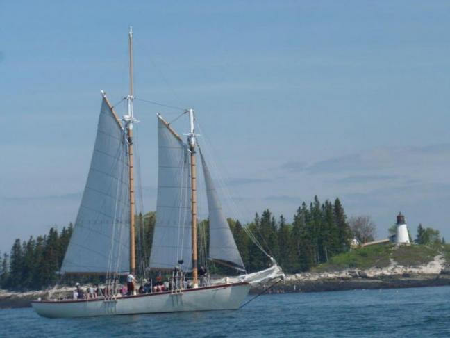 "The schooner ""Eastwind,"" loaded with MSSM students, sailed past the Burnt Island Lighthouse into open water. KATRINA CLARK/Boothbay Register"