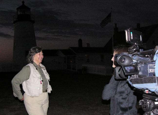Sally Lobkowicz of Mysterious Destinations, left, being interviewed by Jennifer Long of WGME, behind camera, at Pemaquid Point Lighthouse, where a paranormal explore was conducted. Courtesy of Greg Latimer
